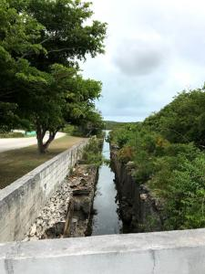 Canal cut through stone to provide salt water to a salt pond, on LI