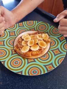 Bahamian bread French toast with peanut butter, bananas, and syrup. Because - why not?