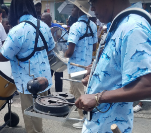 57 Improvised Percussion, St. John Festival Parade (brake drums and compressed gas cylinder cap)